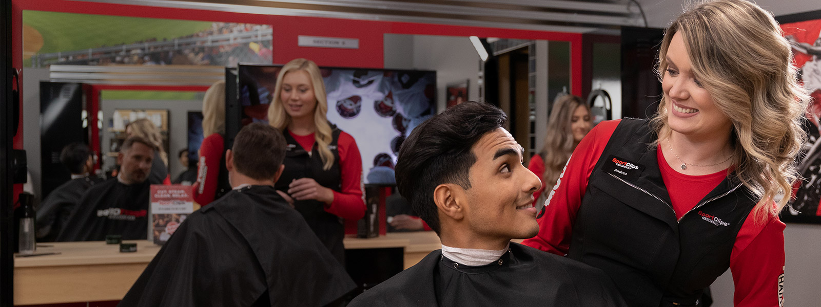 Sport Clips stylist talking to a client